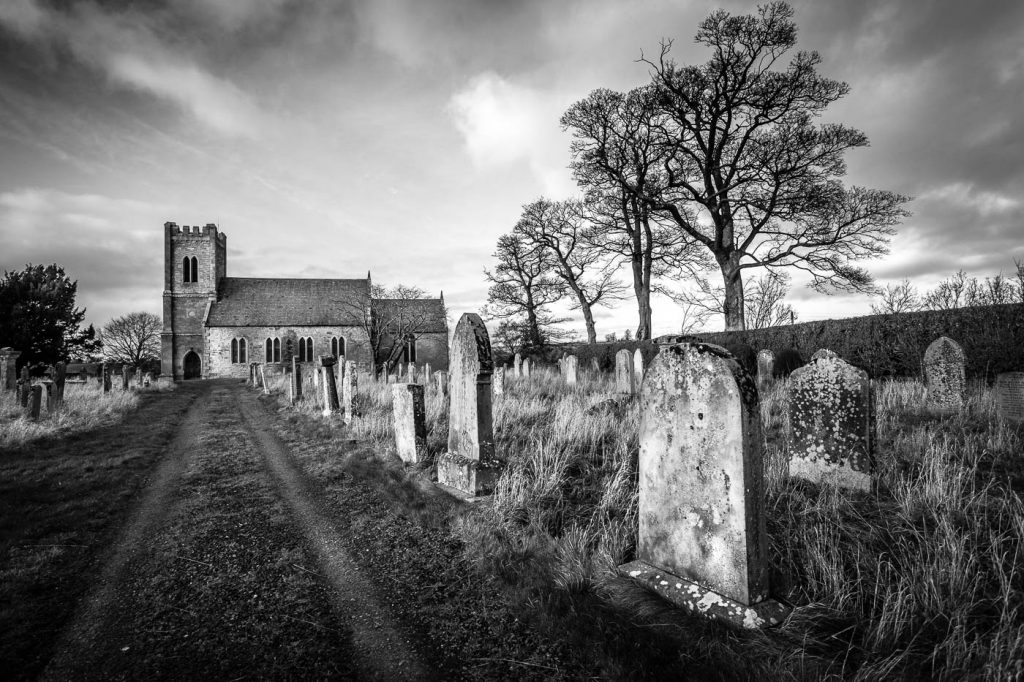 Time's Arrow. Image of churchyard and gravestones as metaphor for time